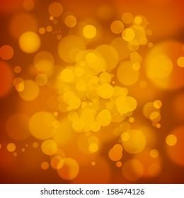 Golden bokeh on warm dark orange background