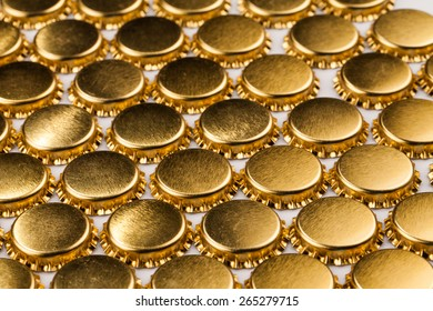golden bottle caps on table