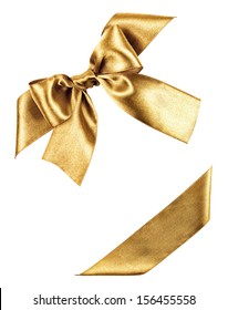 golden bow made from silk ribbon isolated
