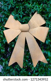 Golden bow on a holiday tree