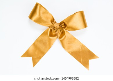 Golden bow on an isolated studio background