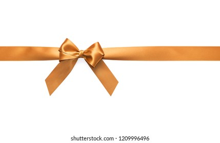 Golden bow on a white background. Preparation for a festive design.