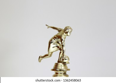 Golden bowling award cup over white background for bowling champion. Gold bowling trophy
