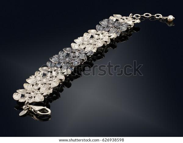 golden bracelet isolated on black background