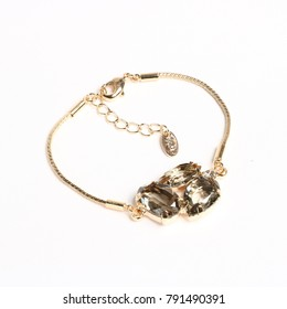 golden bracelet with stones on white background