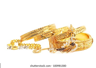 Golden bracelets and necklace with diamonds, over white