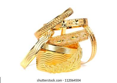 Golden bracelets ,  on a white background