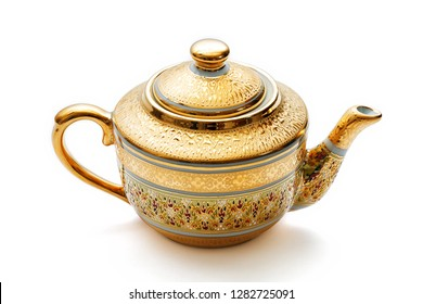 Golden brewing teapot with ornament on white background.