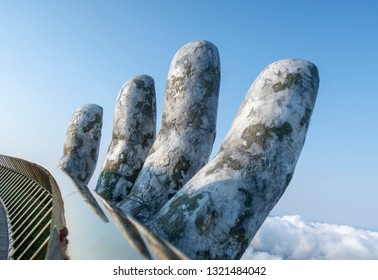 Golden Bridge on Ba Na Hills is a new travel destination that has attracted attention of many tourists over the world. This new architecture is amazing with a pair of giant, stone hands