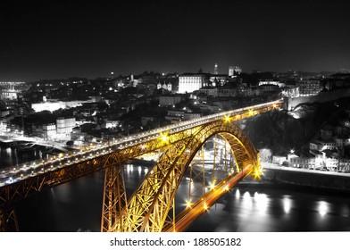 Golden Bridge on a monochromatic background, night view of the  Dom Luiz bridge captured on a slow shutter, Porto , Portugal