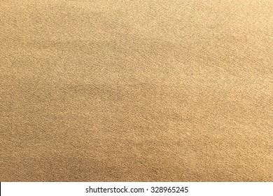 golden bronze color paper texture background for Christmas festive design concept.