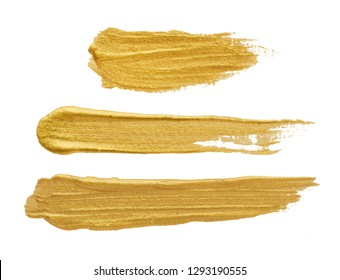 Golden brush stroke on white