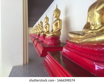Golden Buddha Atatues the belief in and worship of a superhuman controlling power