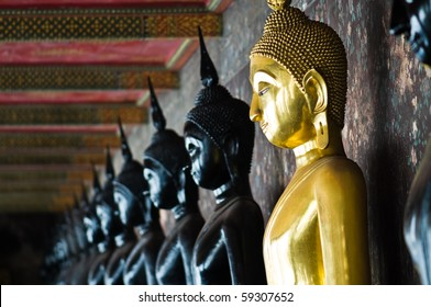 Golden Buddha between black Buddhas, Wat Pho, Thailand