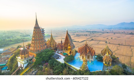 golden Buddha, chedi, temple, pagodas and  Thai architecture building on hilltop. the most beautiful top ten of temples in Thailand