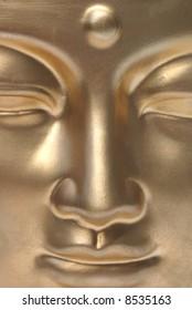 A golden buddha close up.