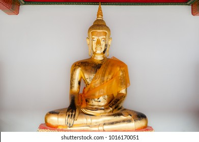 A golden Buddha displayed at Wat Pho, Bangkok, Thailand. Wat Pho, is a Buddhist temple complex in Bangkok, Thailand. The complex houses the largest collection of Buddha images in Thailand.