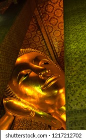 Golden Buddha face at the Wat Pho in Bangkok, Kingdom of Thailand. South East Asia.