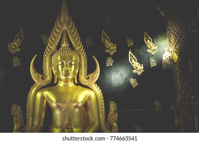 Golden Buddha glittering in the temple.