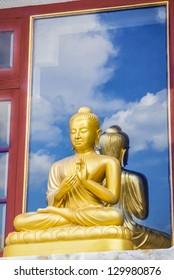 Golden buddha with nice sky