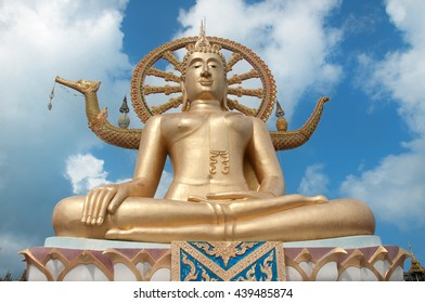 golden buddha on blue sky