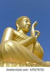 Golden Buddha outdoor with blue sky background