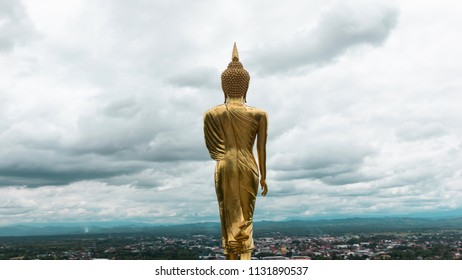 Golden Buddha Standing in a mountain temple