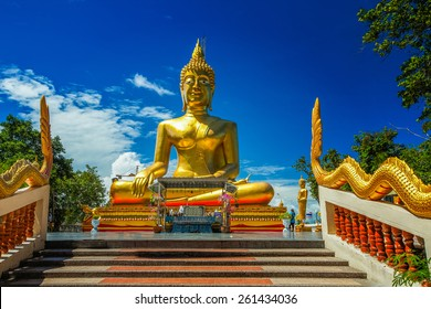 Golden Buddha Statue against blue sky