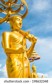 Golden buddha statue with blue sky, Thailand