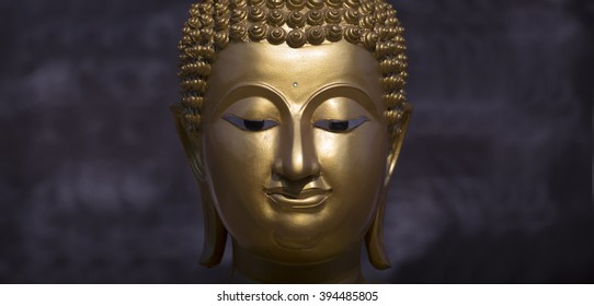 Golden Buddha statue close up