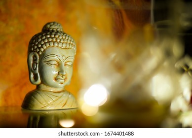 Golden Buddha statue close up .Siddhartha bronze statue. Close up of Buddha beautiful serene face with closed eyes. Best meditation inspiration image or mindfulness background.Copy space.