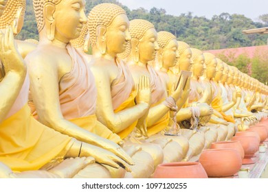 Golden buddha statue and disciple statue in Thailand.