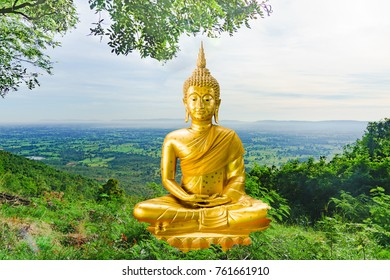 Golden Buddha statue in green forest on mountain and blue sky