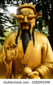 A golden Buddha statue with hands in the eyes in Ten thousand Buddhas Monastery in Hong Kong, China