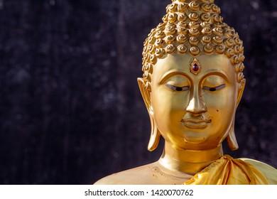 golden Buddha statue head shot