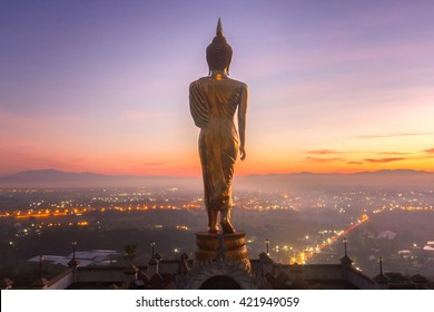 Golden buddha statue in Khao Noi temple at sunrise time, Nan Province, Thailand