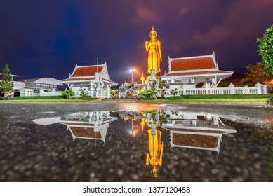 A golden buddha statue on the mountain top at Hat Yai municipality public park, Songkhla Province, Thailand