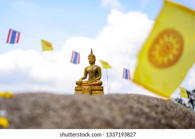 Golden buddha statue on top mountain of Thailand.