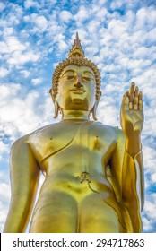 Golden Buddha statue  over blue sky,Tak,Thailand