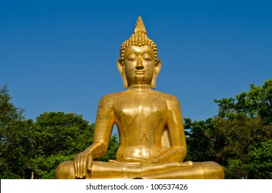 Golden Buddha statue at temple of Thailand
