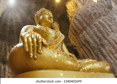 Golden Buddha statue at the temple in Thailand for people to pay homage to the blessing and gilding with gold leaf - Image