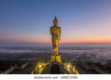 Golden buddha statue in Thai temple Wat Phra That Khao Noi in Nan province Northern of Thailand.