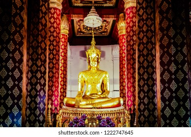 The golden Buddha statue in the thai temple at Ayuthaya.