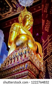 The golden Buddha statue in thai temple at Ayuthaya Thailand.