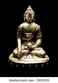 Golden buddha statue from Tibet with black background