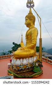 Golden Buddha statue at the top of the Wat Tham Sua in Krabi