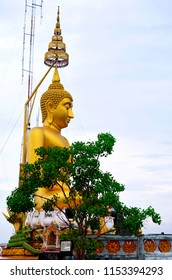 Golden Buddha statue at the top of the Wat Tham Sua