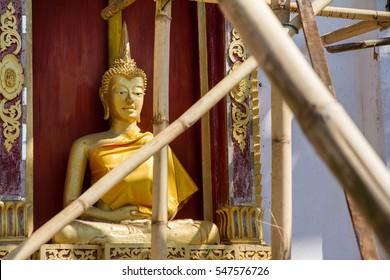 Golden Buddha Statue in under construction temple at Wat Somdej Sangkhlaburi, Kanchanaburi.Thailand.