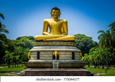 The golden buddha statue in the Viharamahadevi park in the center of Colombo, the capital of Sri Lanka