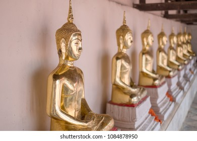 Golden of Buddha statues at Wat Thai Temple worship by sitting concentrate. it's faith of buddhism to pray for god helpful and goodluck in Thailand